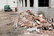 A pile of clay tile bricks is discarded outside the R Street warehouse project. The $41 million project is a joint effort of landowner Capitol Area Development Authority and CFY Development.