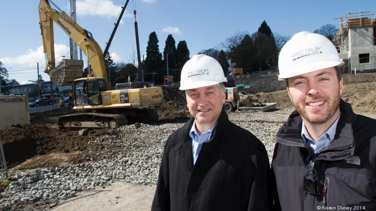 Principals Hal Ferris (left) and Jake McKinstry, of Spectrum Development Solutions, a Seattle real estate company, at the construction site of urban housing project at Yesler Terrace.