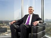 Jim O'Neal, Quanta Services Inc. CEO, sits in the lobby of Quanta's office in the Williams Tower in Houston.