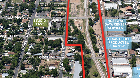 The 11-acre site is just off I-35. It's a slender tract of land, but one that's in the shadows of downtown skyscrapers and next to a rail stop. Click the image to see the proposals for the site.
