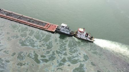A barge loaded with marine fuel oil sits partially submerged in the Houston Ship Channel on March 22.