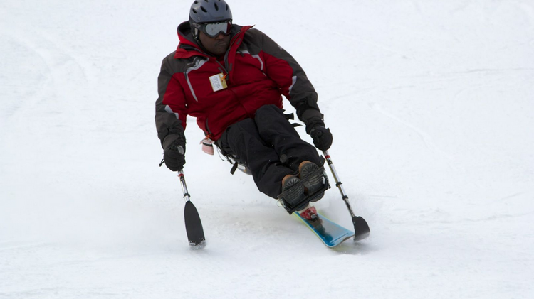 A disabled skier uses the monoski, developed by EFE Labs in Horsham, Pa.