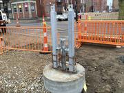 The foundation for the city's first streetcar stop was installed at the intersection of Liberty and Elm streets.