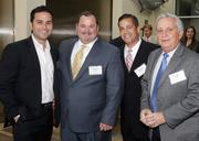 Project of the Year winner Alberto Perez of AJP Ventures with State Street Realty's Ed Lyden, George Pino and Jorge Pino Jr.