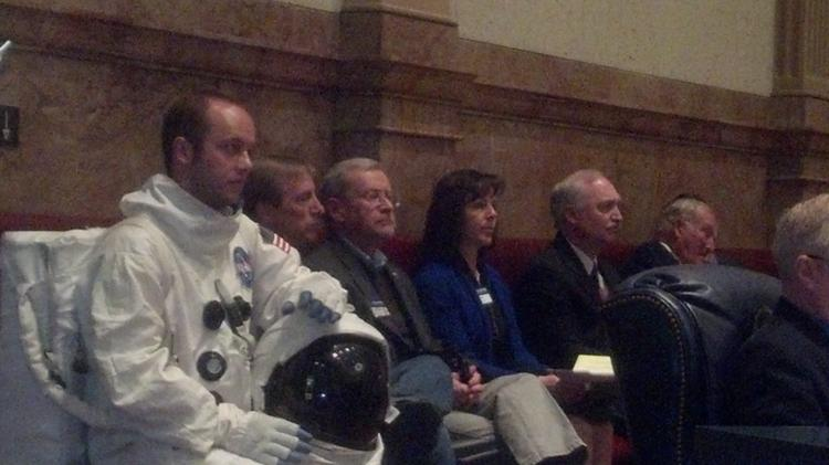 Mike Lotto, a University of Colorado Boulder senior in the school's aerospace program, wears an astronaut's uniform in the Colorado Senate chambers on March 24, 2014, as the Legislature votes to declare the day as Colorado Aerospace Day.
