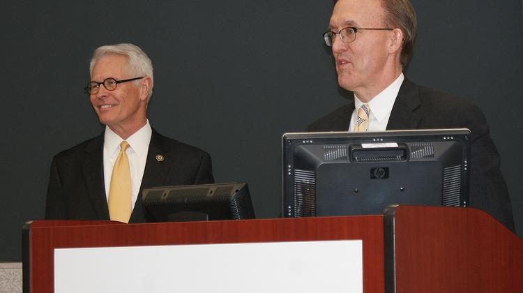 U.S. Attorney Barry Grissom, left, presents an award to Via Christi Health CEO Jeff Korsmo for the protocol Via Christi developed to train health care professionals on recognizing and treating victims of human trafficking.
