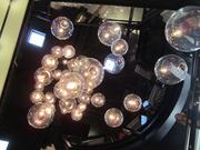 "Dramatic lit ""bubbles"" create a sculptural element that carries through the restaurant's four levels."