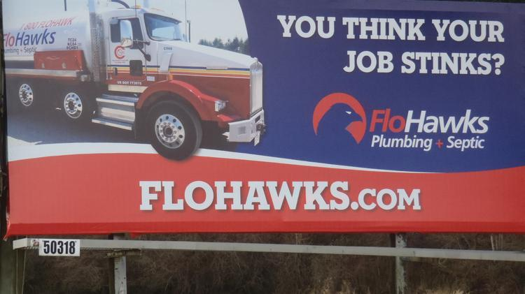 One in a series of billboards around the Puget Sound region for septic and plumbing company FloHawks.