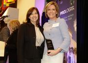 Blanca Commercial's Danet Linares and Tere Blanca with their award for Office Lease of the Year.