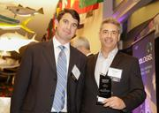 CBRE's Devin White and Chris Lee with their award for the Industrial Sale of the Year.