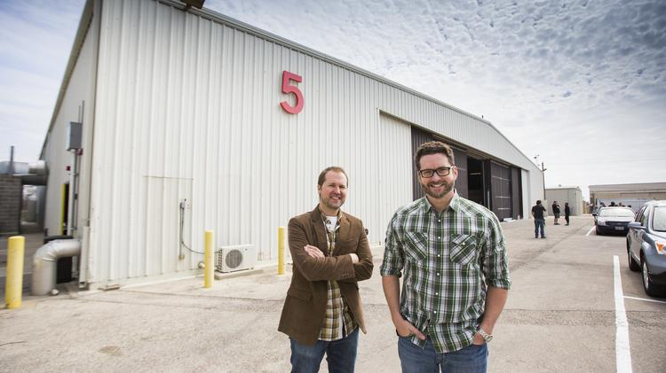 Matt Hullum and Burnie Burns of Rooster Teeth at the company's new Austin location.