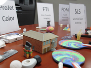 """Central 3D Systems, a 3-D Printer distributor in Waukesha, held an open house on Thursday and Friday demonstrating how the work is done. All of the items on this table were """"printed."""""""