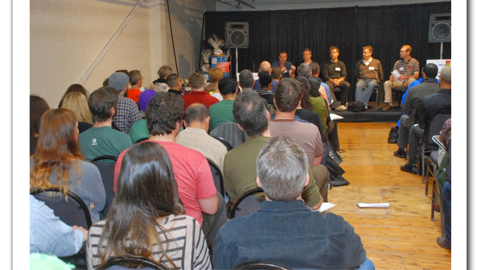 The crowd and a panel at last year's Launch Pad event.