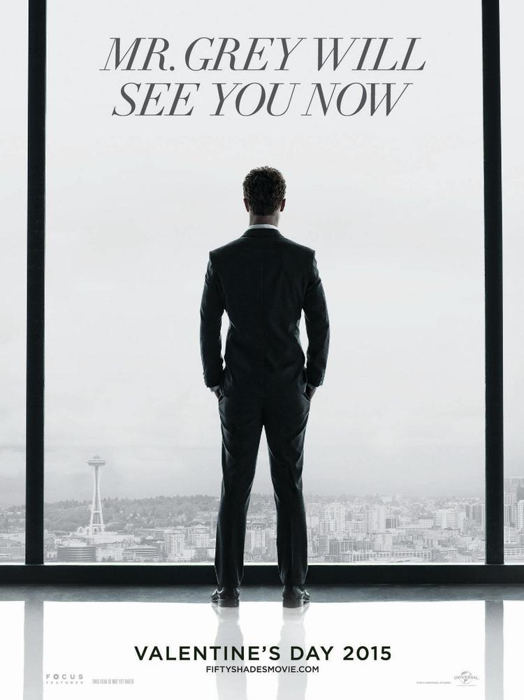 "The ""Fifty Shakes of Grey"" trailer screened for exhibitors Tuesday morning barely hinted at the kinky content, focusing instead on the characters' introduction to each other and the rising heat between them."