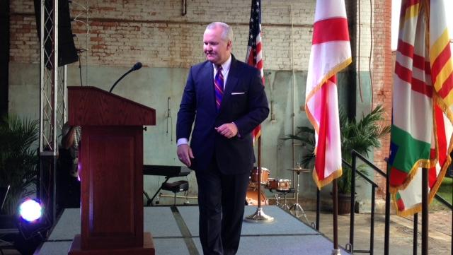 Tampa Mayor Bob Buckhorn leaves the stage after his speech.