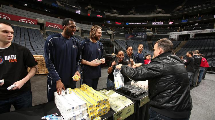 The Charlotte Bobcats teamed with volunteers from Wells Fargo and Family Dollar to put together care packages for U.S. military members on Tuesday.