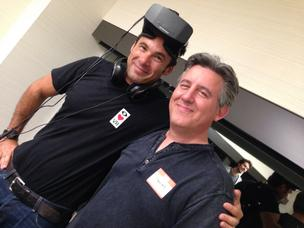 Antonio Rodriguez, general partner at Matrix Partners, poses with Oculus VR's headset alongside science fiction author Daniel Suarez.