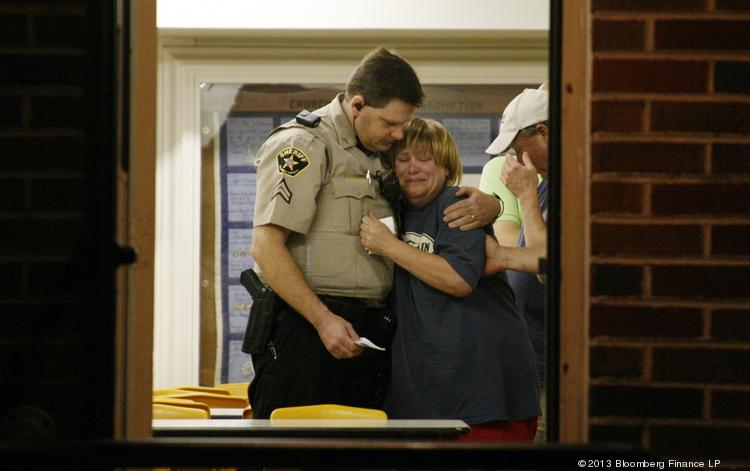 An unknown woman is consoled by a Sheriff's Deputy at a command post in West on Thursday.