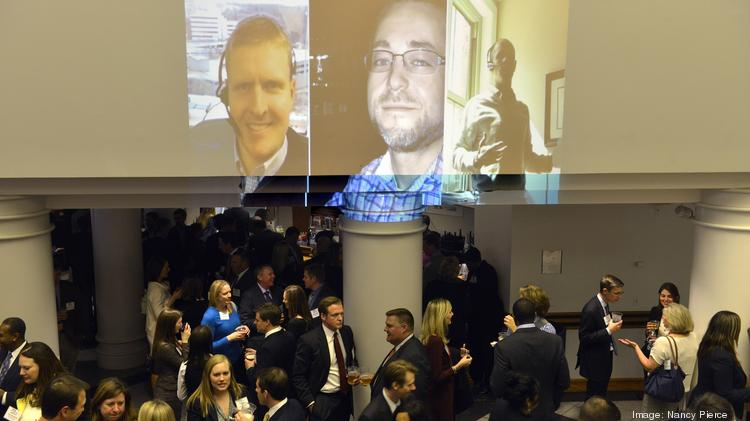 "The Charlotte Business Journal hosted its 21st annual 40 Under 40 awards reception on Tuesday, March 25, honoring some of the area's best and brightest young professionals. Here, event attendees network prior to the awards presentation as photos from the winners' ""selfie challenge"" are projected on the wall. Flip through these photos for a look at the event."