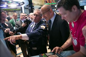 Riccardo Zacconi, chief executive officer and founder of King Digital Entertainment (center, in glasses), watches as the stock launches on the NYSE.
