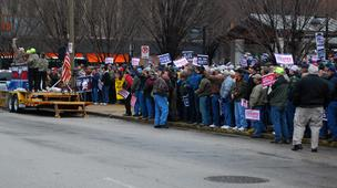 Members of the United Mine Workers of America marched outside Peabody Energy's headquarters Tuesday morning.