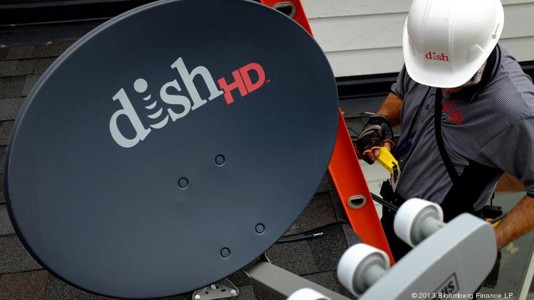 Justin Preziosi, field service specialist for Dish Network Corp., installs a satellite television system at a residence in Denver.