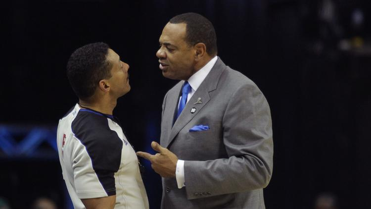 Coach Lionel Hollins gets up close with a ref