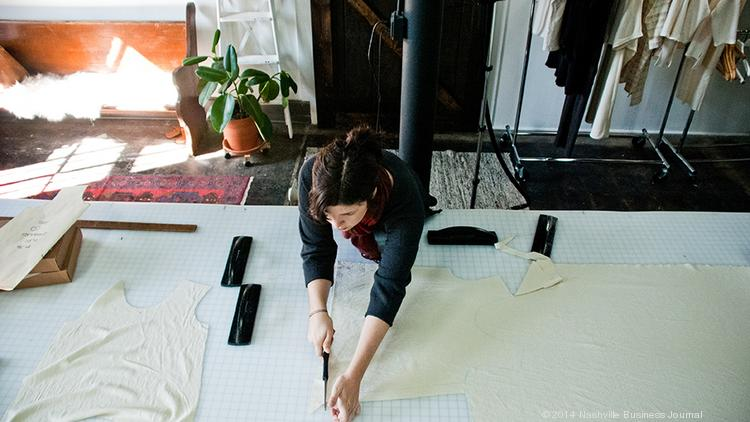 Fashion designer Elizabeth Pape works in her Church Street studio in Midtown, where she designs and makes clothing for her Elizabeth Suzann brand. Pape has been working on items for her spring line, which debuted this month.  Photo by Nathan Morgan | Nashville Business Journal