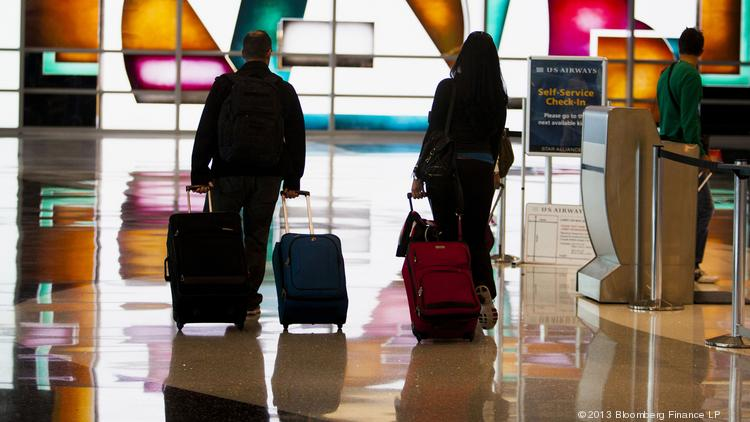 Travelers walk through San Diego International Airport. Business travelers have specific habits, likes and dislike. Here's some in-house research to tell you what a business traveler is like.