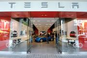 Tesla operates showrooms in some states, but it sells its cars primarily via phone and online.