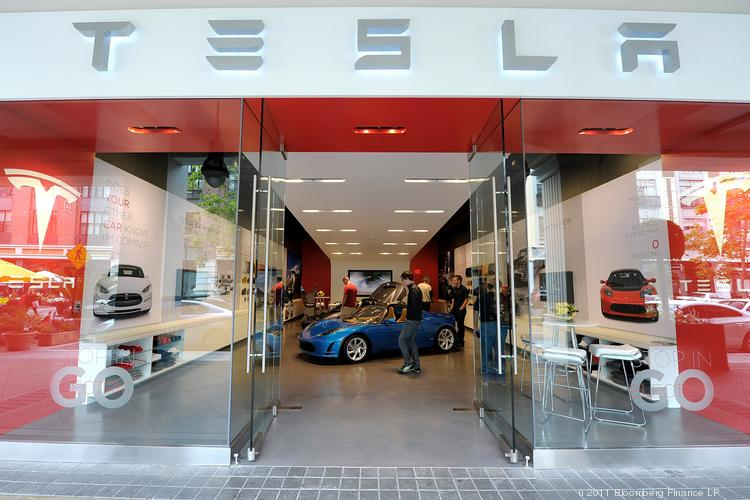 Customers browse the Tesla Motors Inc. showroom in San Jose. The company this week lost a wrongful termination lawsuit against a former employee, and was ordered to pay $207,000.