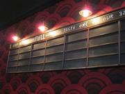 A rotating list of local beers served during the movie or in the adjacent Glass Half Full bar will be listed on a chalkboard.
