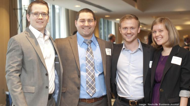 Rob Bellenfant, left to right, with Keith Crawley, Jordan Schneider, and Heather Neisen, all of TechnologyAdvice.
