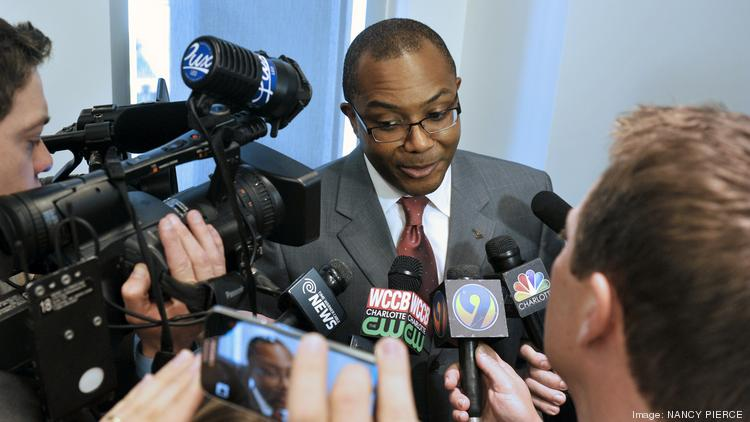 Charlotte Mayor Pro Tem Michael Barnes is pictured here, surrounded by reporters, at a press briefing that took place shortly after the FBI's arrest of former Mayor Patrick Cannon in March.