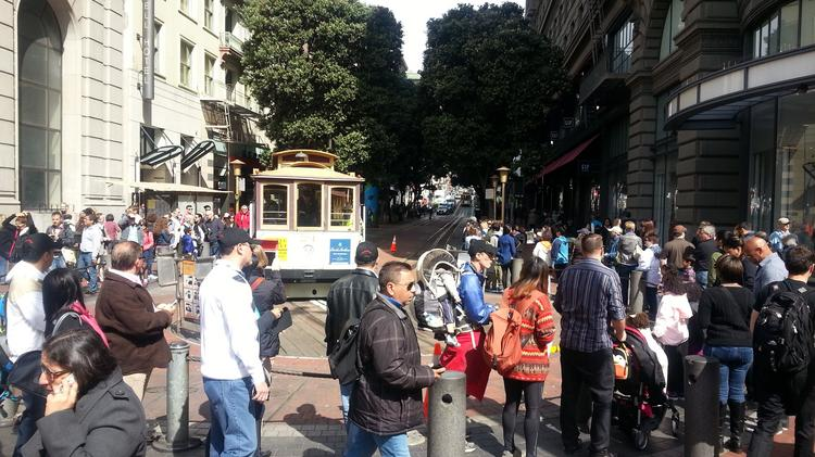 People get ready to board a cable car at the Powell Street turnaround. Tourists in San Francisco spent a record-breaking $9.4 billion last year and 16.9 million people visited the city.