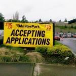 Wage rage: Former employee sues SeaTac parking company over $15 wage