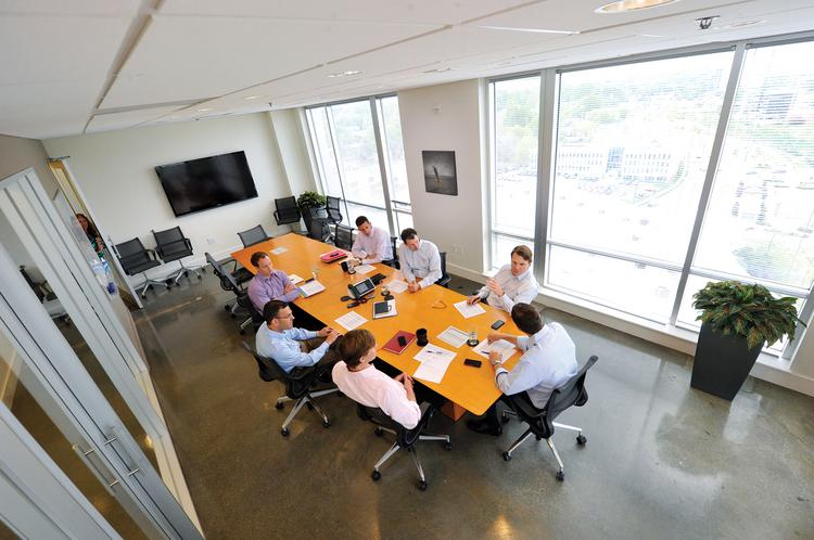 Frontier Capital's investment team at a Monday morning strategy session. Clockwise from top right are: Richard Maclean, Andrew Lindner, Seth Harward, Michael Ramich, Scott Hoch, Tim Bechtold and Joel Lanik.