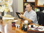 Dr. Josh Green is seen in his Senate office at the Hawaii state Capitol.