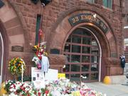 The number of flower bouquets is growing in front of the Engine 33 Fire Station on Boylston Street in the Back Bay in tribute to fallen firefighters Edward Walsh and Michael Kennedy who perished in the 9-alarm blaze at 298 Beacon St. in the Back Bay on Wednesday.