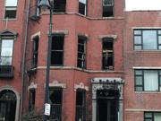 The gutted four-story brownstone at 298 Beacon St. in Boston's Back Bay where two firefighters were killed.