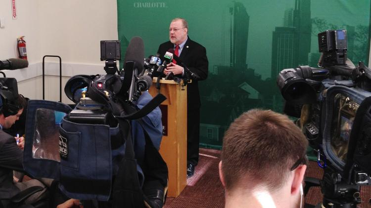 Charlotte city manager Ron Carlee speaks to reporters in the wake of the mayor's resignation.
