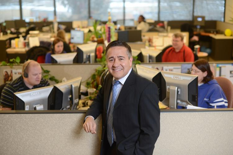 Ralph Martinez, who leads Comcast's Twin Cities region, discusses the growth of business services, defends rate hikes and names his favorite wine.
