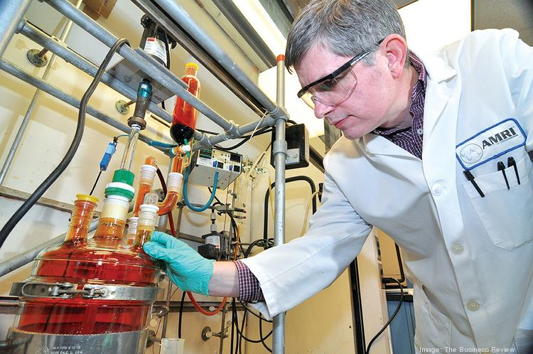 Associate research fellow Robert Duguid works in AMRI labs in Albany.