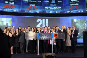 2U CEO Chip Paucek and others celebrate the ed-tech company's IPO on Friday.
