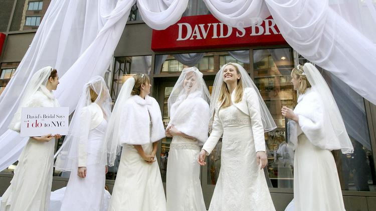 Models dressed in wedding dresses celebrate the opening of David's Bridal store in Manhattan, which happens to be the most expensive city in America for weddings. Big Apple wedding bashes push the $90,000 mark according to a new survey by TheKnot.
