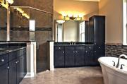 A bathroom by Master Craft Builder Group.
