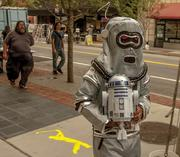 Robauto's Chris Savage was dressed as a robot during One Spark's first day. The downtown festival runs until Sunday.