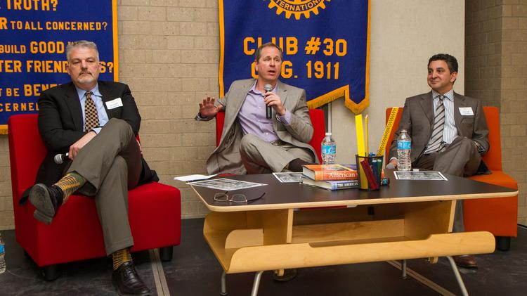 Wichita property developers Michael Ramsey, Gary Oborny and George Laham take part in a panel discussion during Monday's Rotary Club of Wichita Meeting at Botanica, 701 Amidon St.