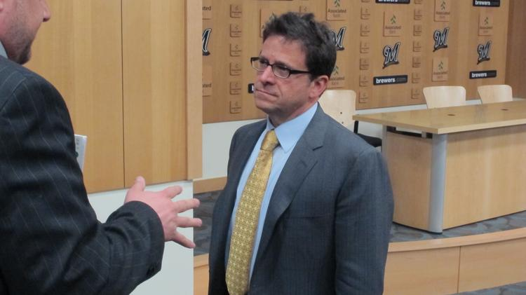 Mark Attanasio is interviewed in the Brewers' press room on Opening Day March 31.