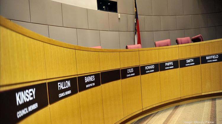 The mayor's seat in the Charlotte City Council chambers stands blank after the arrest and resignation of Patrick Cannon. Council spent 20 minutes in session before adjourning Monday. Mayor Pro Tem Michael Barnes presided over the meeting, with Cannon's chair empty and his nameplate stripped from the dais.